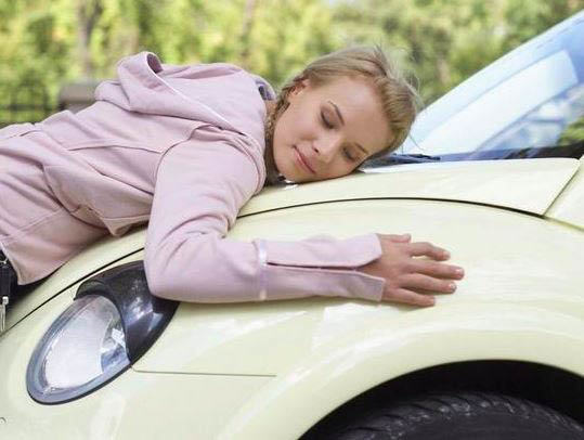 photo of woman hugging car at Fifties Oil Change in Canton, MI