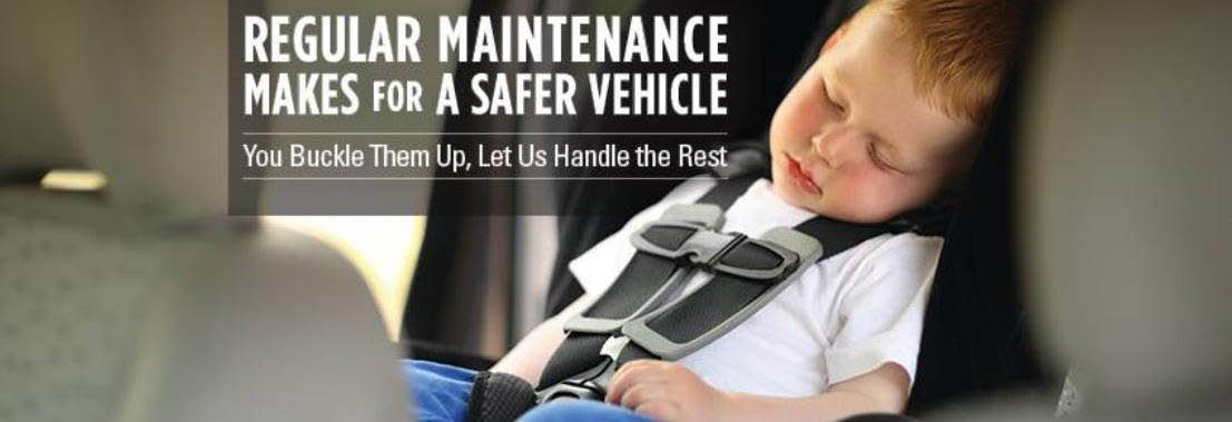Child sleeping in back seat with seat harness attached