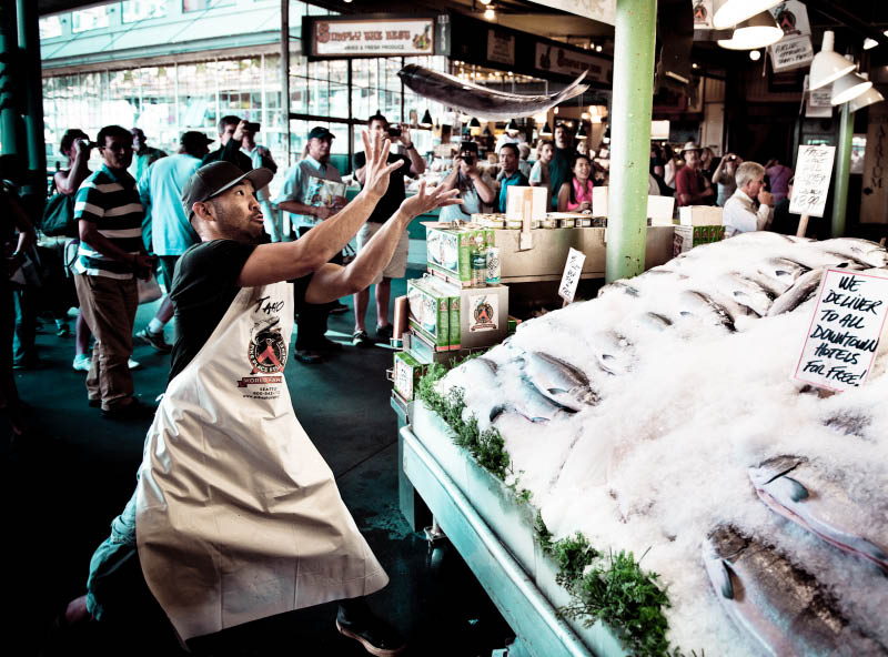 Fish throwing at Pike Place Fish Market - Seattle, WA - Pike Place Market - we're the guys that throw the fish! - seafood market
