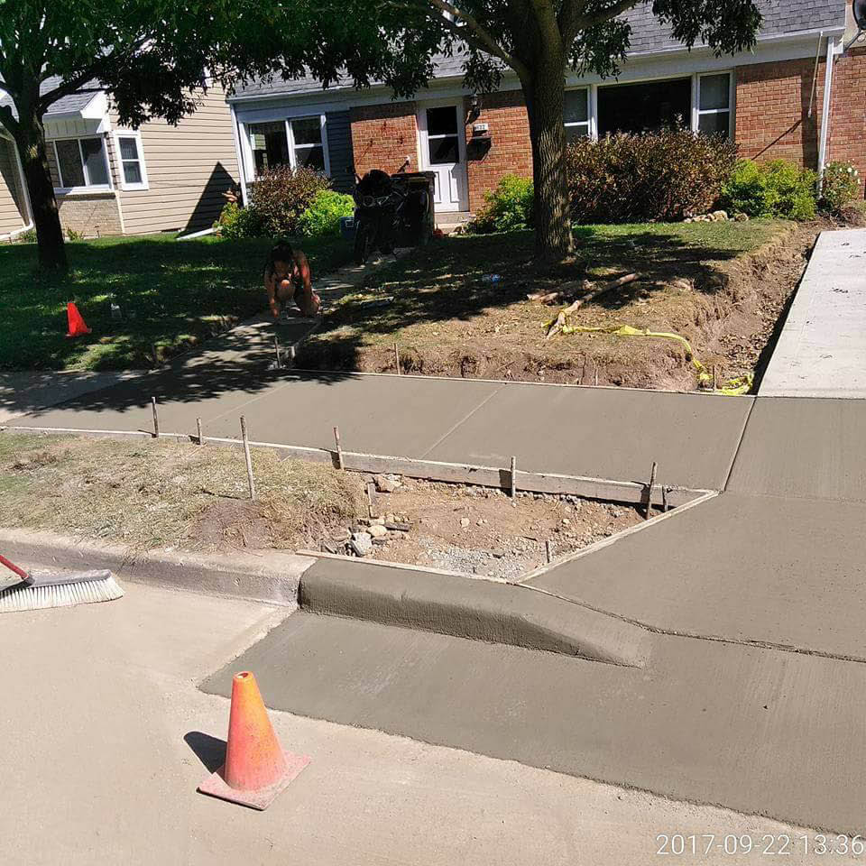 new driveway being poured at a brick house in Wisconsin; concrete contractors; driveway repair