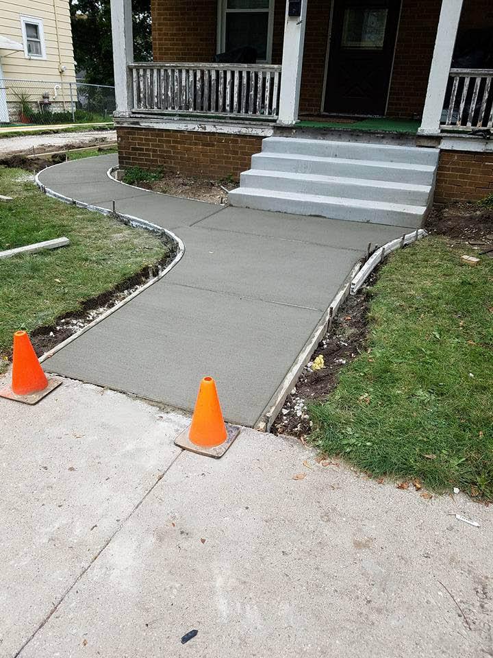 new concrete walkway to front doorsteps in Wisconsin.