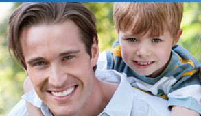 photo of father and son, patients at Fox & Berman DDS