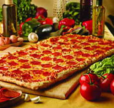 Large family pizza with pepperoni and breadsticks