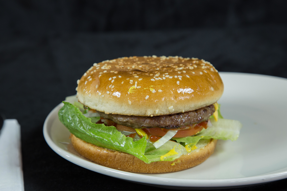 Burger with lettuce tomato and onion.