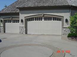 Steel garage door with new garage door remote installed by O'Brien Garage Doors in Minneapolis, MN