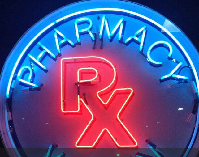 photo of neon pharmacy sign representing Garfield Drugmart in Clinton Twp, MI