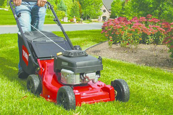 lawnmower cutting grass on a residential property