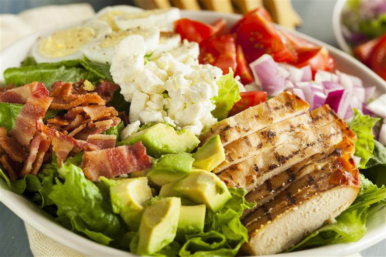 Caesar Salad with bacon, eggs, avocado grilled chicken and more
