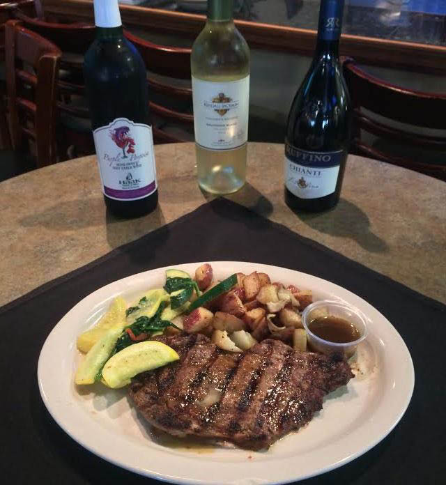Steak and potatoes with wine at Dickinson Italian Restaurant