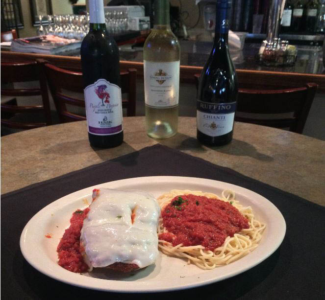 Chicken parmigiana with spaghetti and red wine and white wine