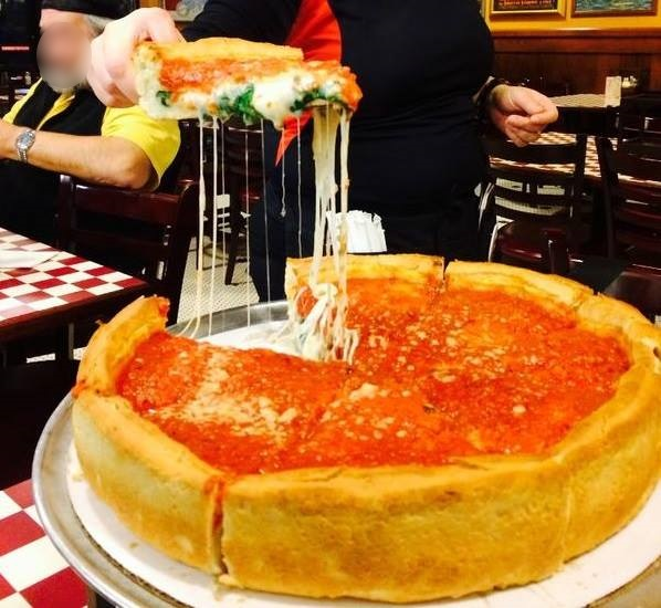 Giordano's Chicago-style deep dish pizza restaurant in Rockford is so stuffed with fresh ingredients, cheese and tomato, that one piece is filling.  When you cut out the first stuffed pizza piece,  you are amazed at all the fresh ingredients in one piece.