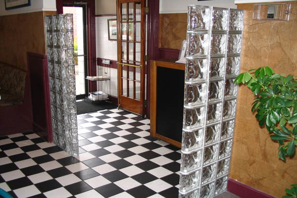 A commercial entrance with glass block dividers