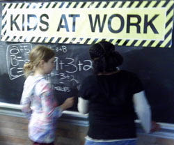 Picture of kids at a chalk board at Glendale Heights in Bayside.