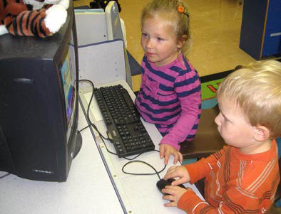 Picture of kids on a computer at Glendale Heights in River Hills.