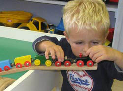 Picture of a boy playing with a train at Glendale Heights in Brown Deer.