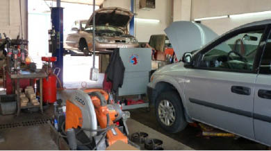 Picture of a car being serviced at Gordon's #1 Service near Pewaukee, WI