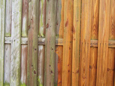 Photos of a fence before and after pressure washing provided by Graffiti Busters in Seattle, WA - pressure washers in Seattle, Washington