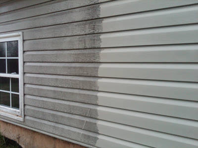 Photos of house siding before and after pressure washing provided by Graffiti Busters in Seattle, WA - pressure washing - graffiti removal
