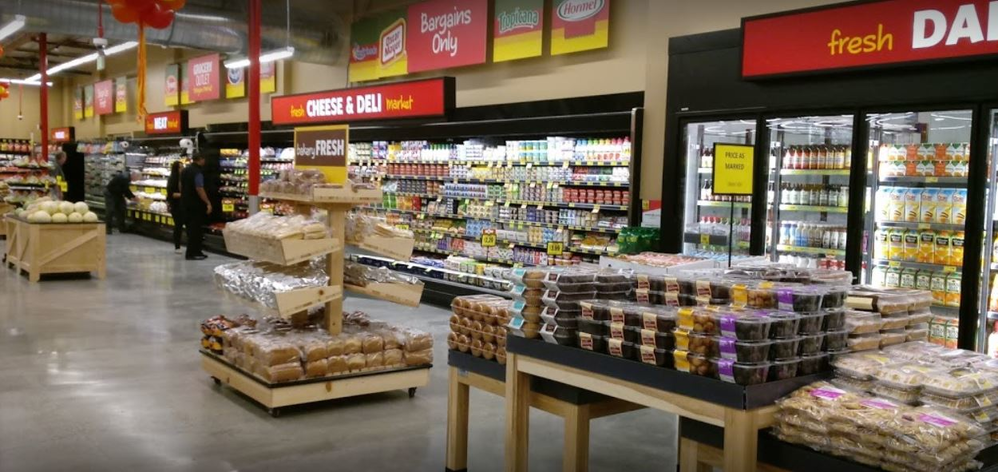 Dairy department and cheese and deli department inside the Bridle Trails Grocery Outlet Bargain Market in Kirkland, WA - Kirkland grocery stores - grocery store coupons near me - grocery stores in Kirkland