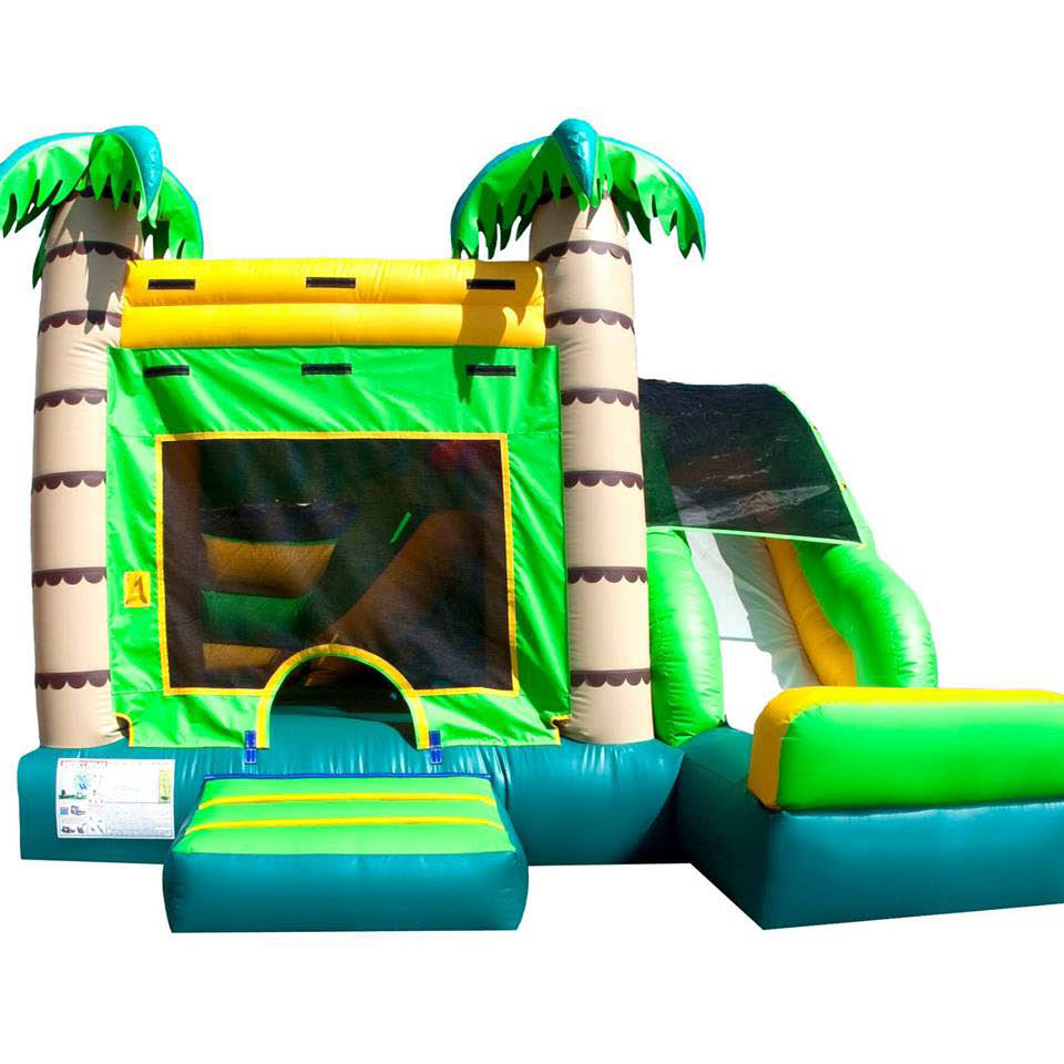 Bounce house with palm trees and side slide