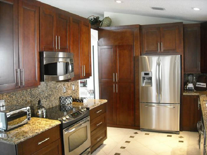 New darkwood cabinets and counters