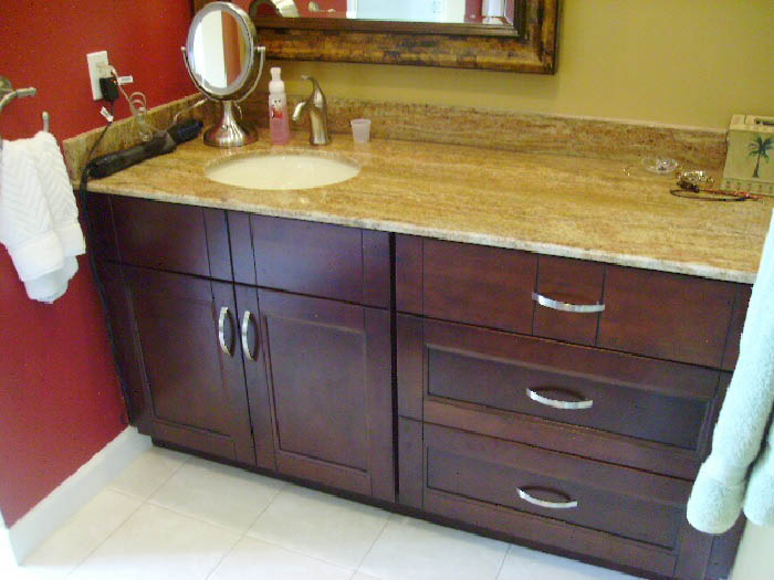 Darkwood bathroom cabinet with granite counters