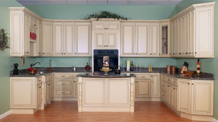 Beige wood cabinets and drawers with granite counters