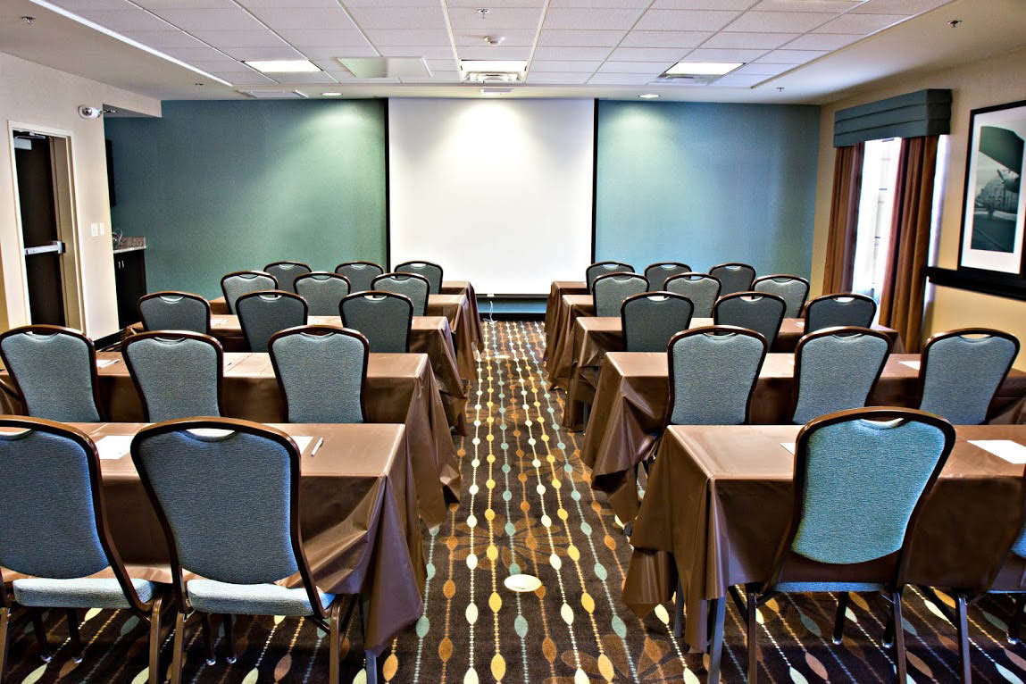 Event & conference room. Amenities include business center, fitness center, & Wifi.