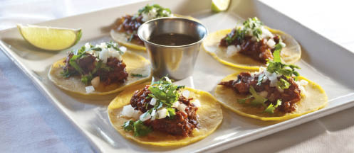 Gourmet tacos with dipping sauce near Bear Creek