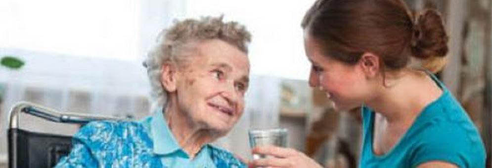 photo of elderly woman and young caretaker representing Home Help Care Providers in Lincoln Park, MI