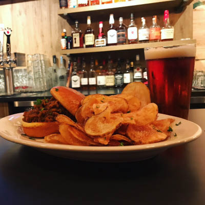Located conveniently at 218 South Washington Street, Board & Barrel is a vibrant Restaurant Naperville IL serving up creative takes on classic American-style pub food with many excellent craft beers on tap.