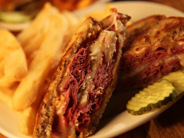 New York deli-style corned beef with melted Swiss cheese, sauerkraut and Thousand Island dressing on grilled seeded rye bread.