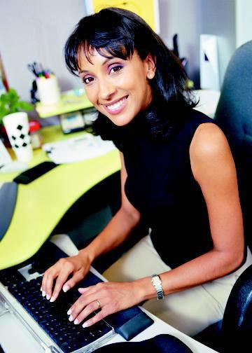 IRS Recruiting: Smiling IRS worker using computer keyboard in Weber & Davis County, Utah.