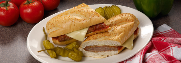 Hot sub sandwiches surrounded by fresh-baked bread