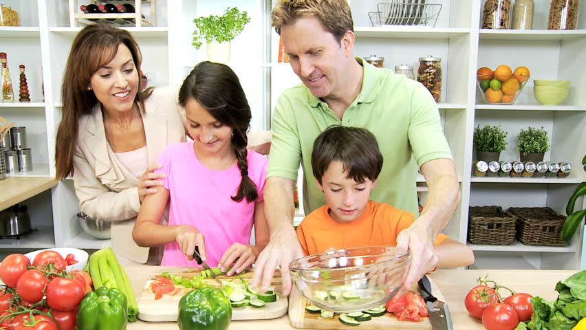 Family preparing a health meal with advice from a health coach - Invincible Health & Wellness - sustainable strides for the whole family - eat healthy - health coach - health & wellness coach