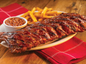 Slow cooked BBQ smoked ribs with sides of fries at JD's Q & Brew