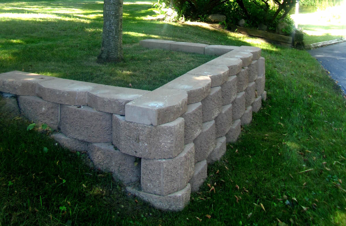 Picture of Landscaping: custom built retaining wall around a tree in Menomonee Falls