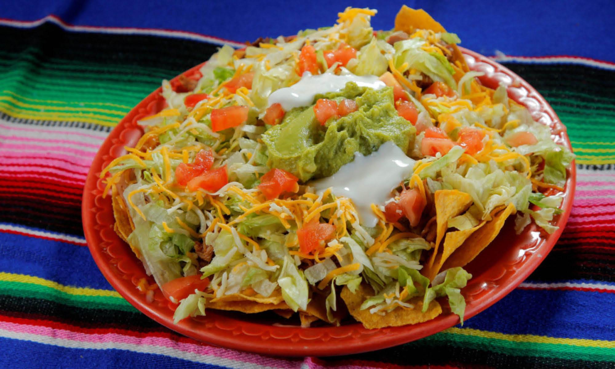 Try our Nachos Supremos. Add guacamole and sour cream.