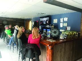 Jemmas Slots customers at bar.