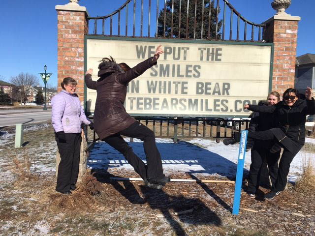 We Put the Smiles in White Bear sign
