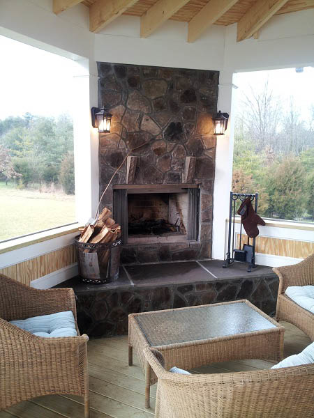Fireplace installed in a screened in porch