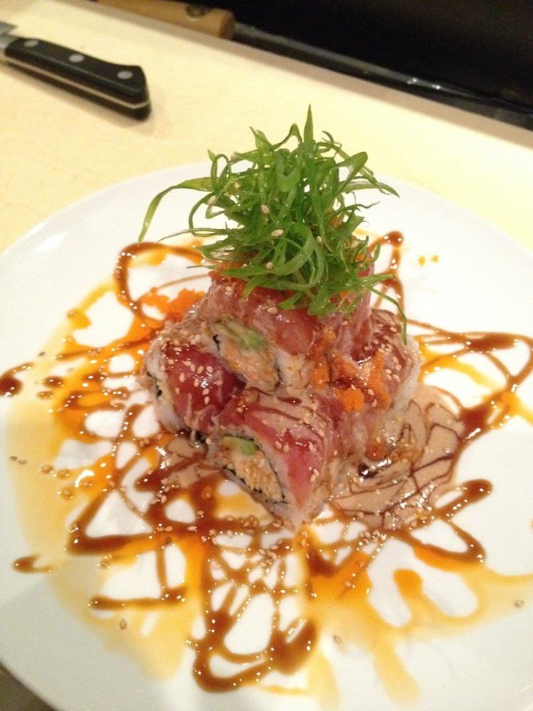Taste elegantly prepared fresh fish, sushi rolls and sashimi