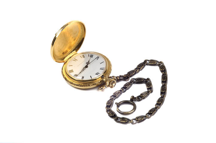 Old fashioned pocket watch with chain