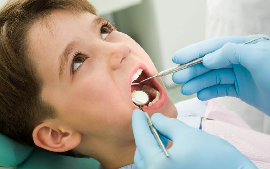 Kid's dentistry at Angel Smiles Dentistry in Kirkland, WA - dentistry for kids and adults in Kirkland - Kirkland dentists near me - dentistry coupons near me - dentist coupons near me - kid's dental cleaning - dentistry for children