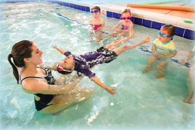 young children learning how to swim