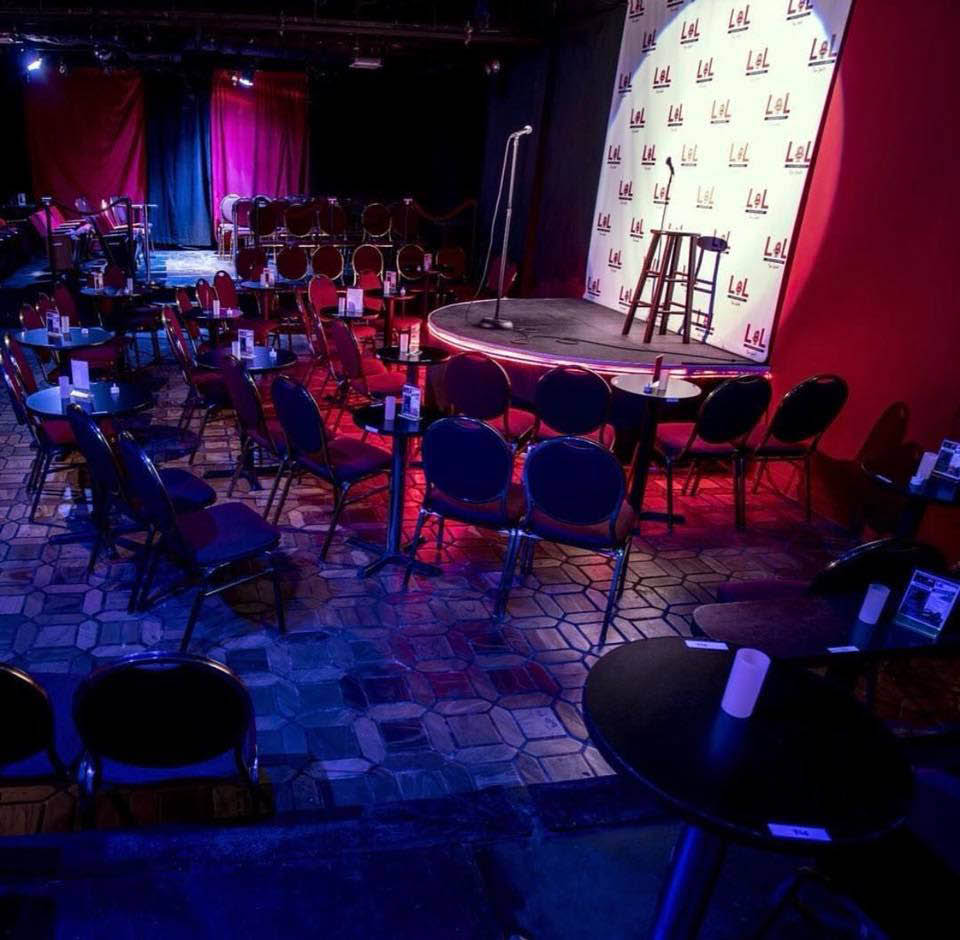 Live stand-up comedy on stage at LOL Comedy Club in NYC