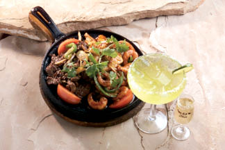 Freshly made steak fajitas with margarita