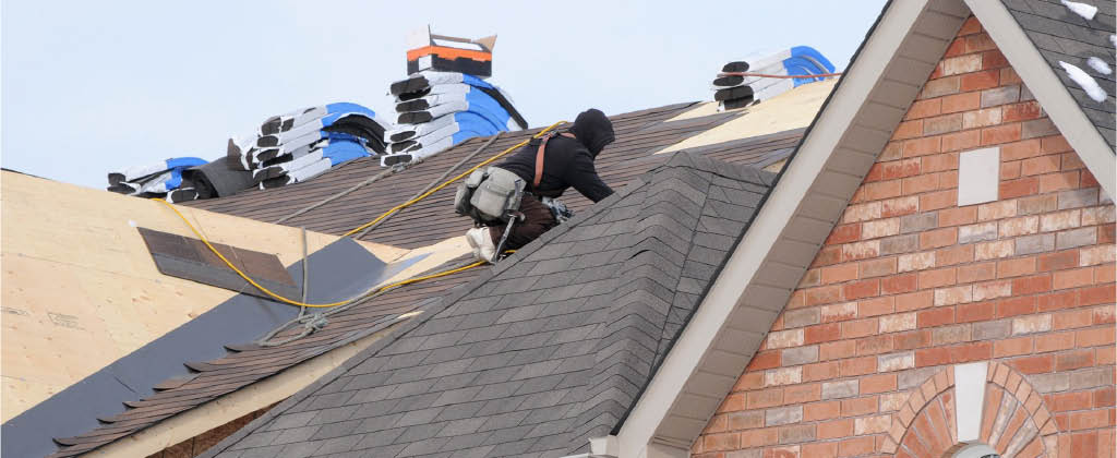 Professional roofers from Bliss Roofing installing a new roof on a house - residential roofing - quality roofing company