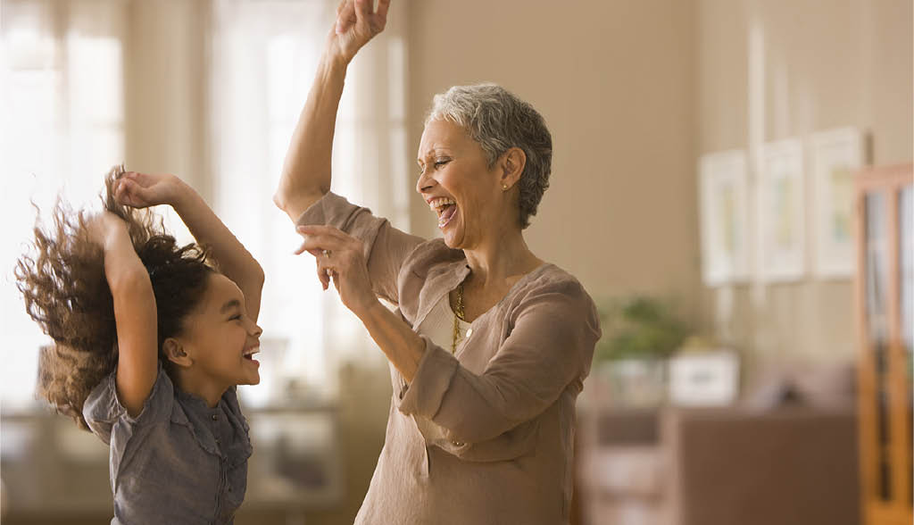 Grandmother dancing with her granddaughter - grandmother feeling great with health coaching from Sonda Swanberg at Invincible Health & Wellness in Lakewood, WA - sustainable body - health coaching - lifestyle coaching