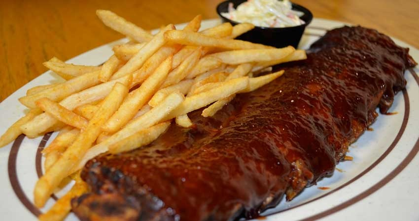 barbecue ribs and french fries from Legends Tavern and Grille in Sunrise, FL